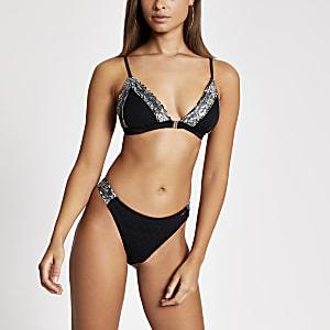 Zwart hoogopgesneden bikinibroekje met bies aan zijkant