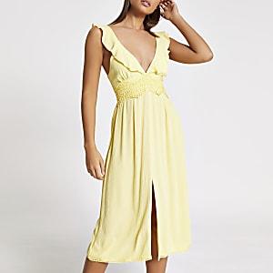 Gelbes Midi-Strandkleid mit Dekolleté aus Spitze und Rüschen