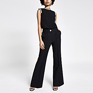 Black flare embellished button trousers