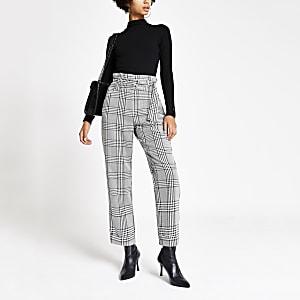 Zwarte smaltoelopende broek met ceintuur en print