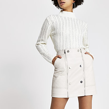 Cream quilted faux leather mini skirt