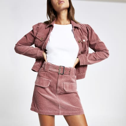 Pink corduroy belted mini skirt