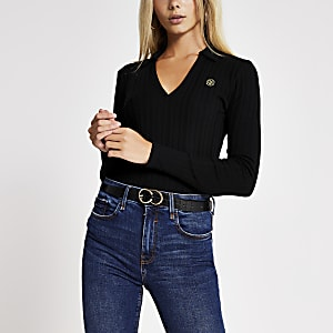 Langärmeliges, schwarzes RI Poloshirt im Rippenstrick