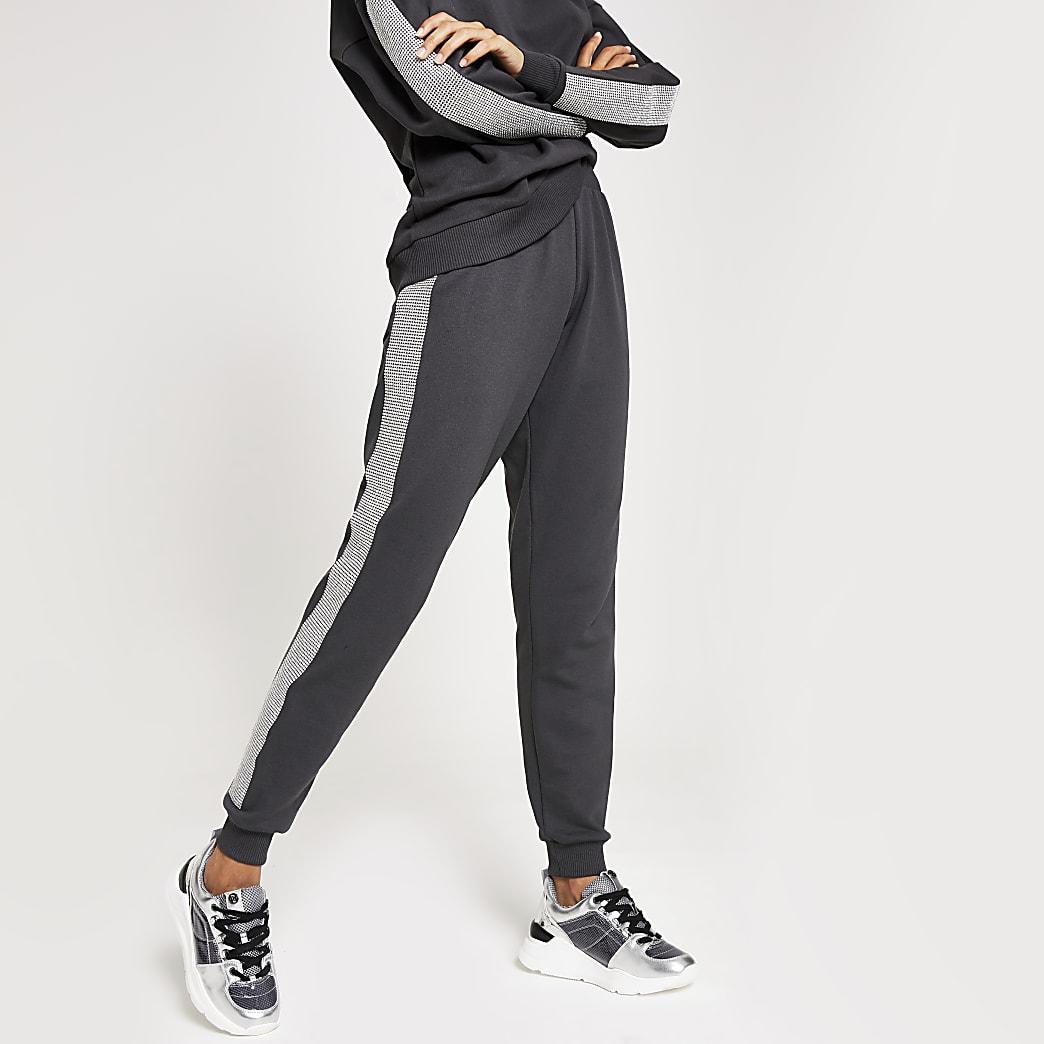 Pantalons de jogging gris ornés de strass sur le côté