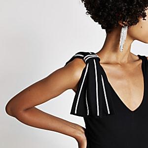 Zwarte mouwloze bodysuit met strik met siersteentjes