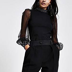 Top noir à manches longues transparentes avec garniture ornée