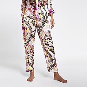 Pantalons de pyjama larges roses imprimés en satin