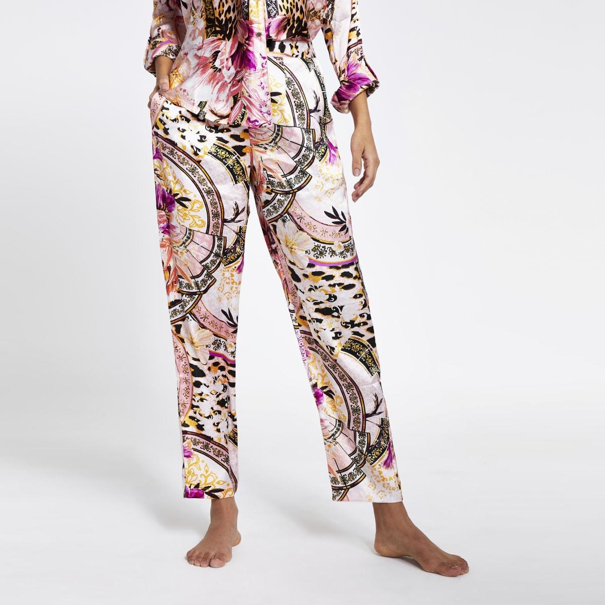 Roze satijnen ruimvallende pyjamabroek met print