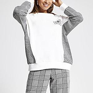 Crème sweatshirt met ruitenprint op de mouwen
