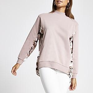 Roze hoogsluitend sweatshirt met kleurvlakken en print