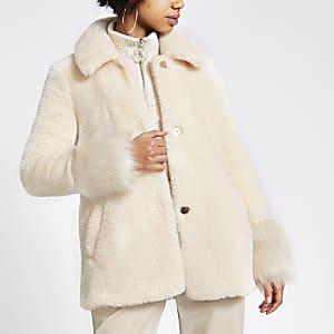 Cremefarbener, langärmeliger Mantel aus Kunstfell