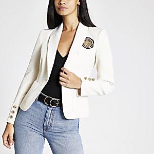 Crème blazer met geborduurde badge