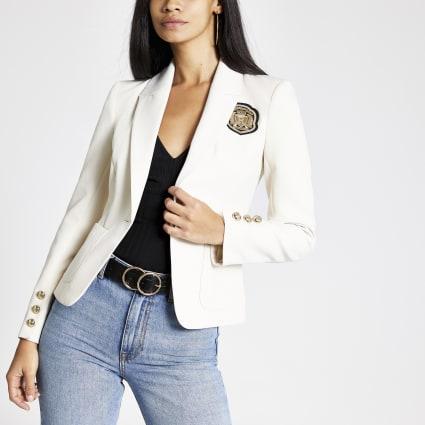 Cream embroidered badge blazer
