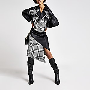 Zwarte midi-rok met pied-de-poule-vlakken en omslag