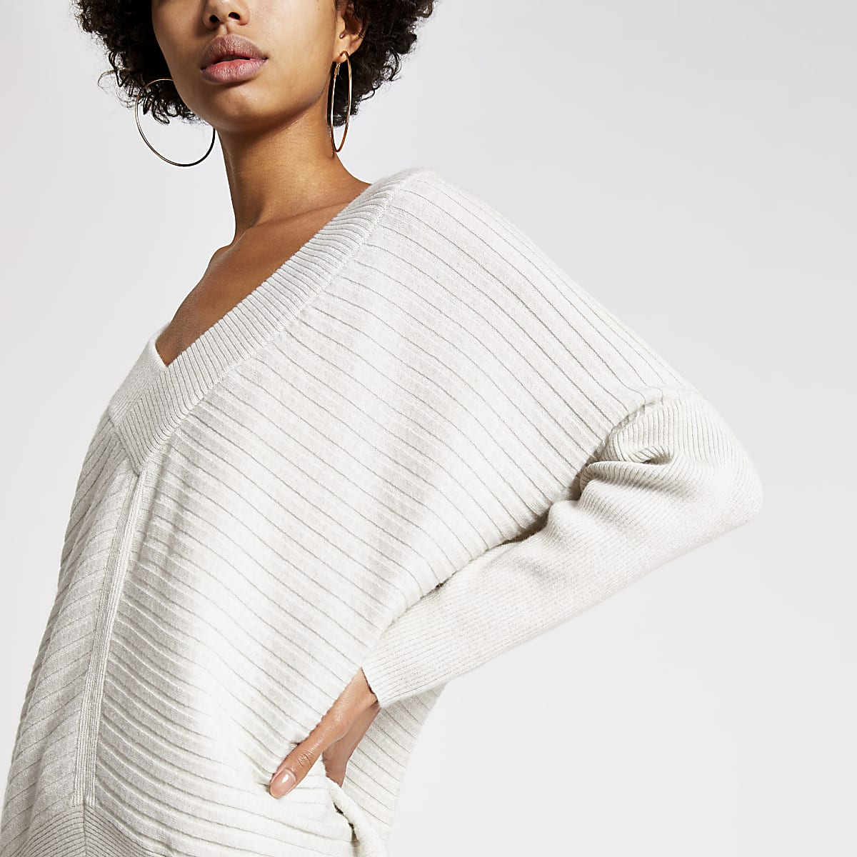 Crème gebreide geribbelde pullover met V-hals