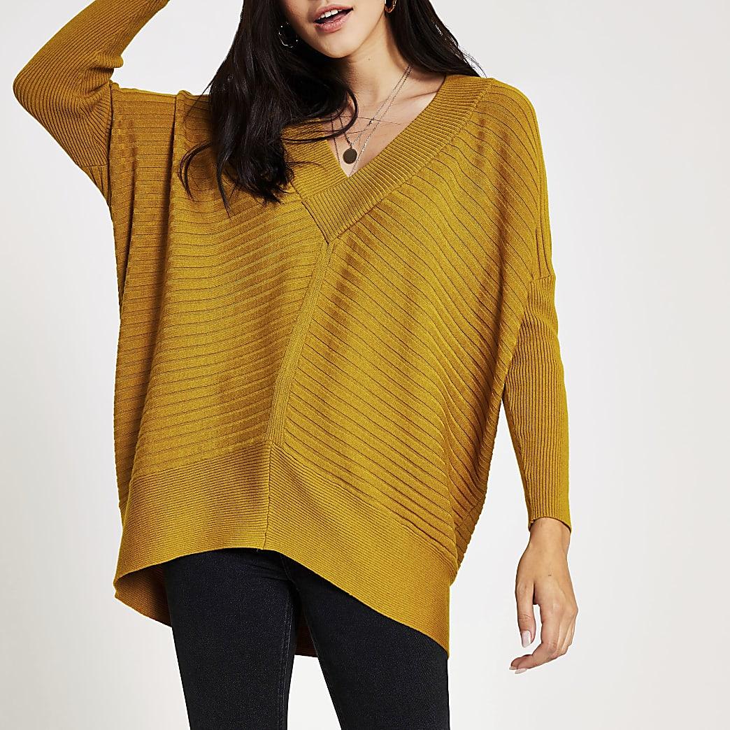 Gele gebreide geribbelde pullover met V-hals