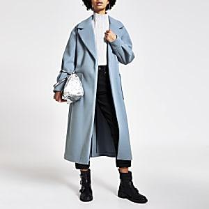 Manteau long bleuà manches ballon et ceinture