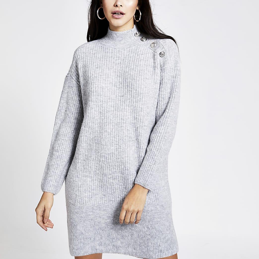 Grijze gebreide trui-jurk met knopen op de schouder