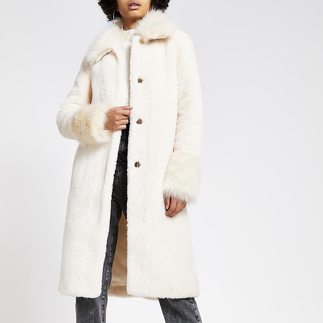 Crèmekleurige lange jas met imitatiebont