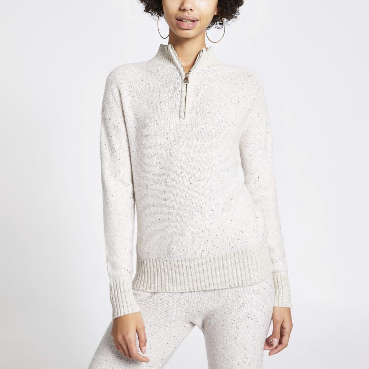 Beige gebreide trui met halve ritssluiting en lovertjes
