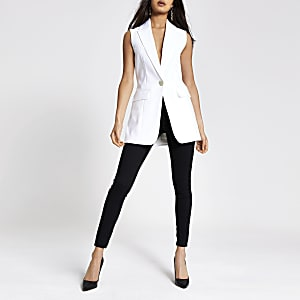 White sleeveless longline blazer