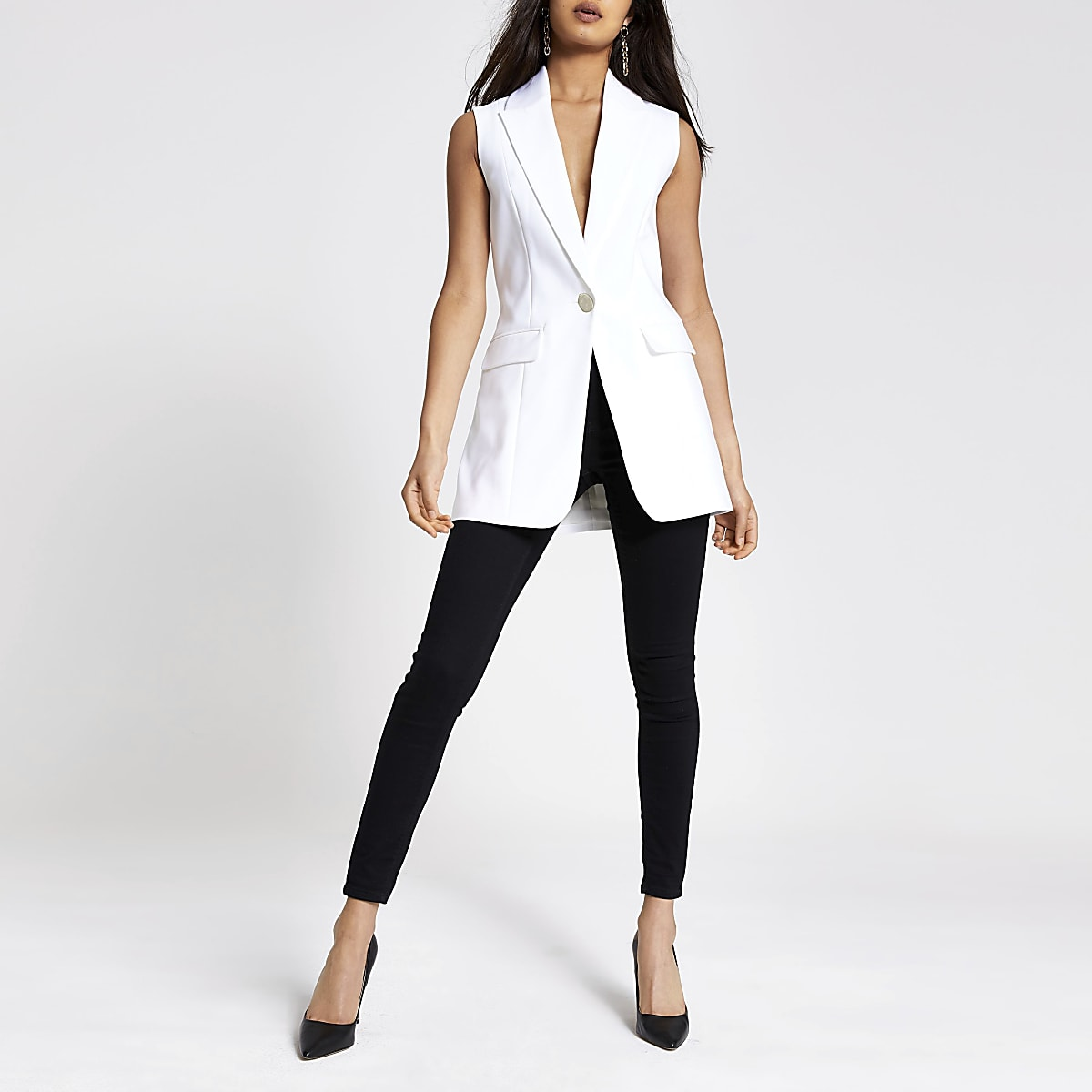 White sleeveless longline blazer