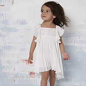 Mini girls cream pleated flower girl dress