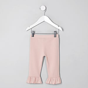 Legging rose avec ourlet évasé à volants mini fille