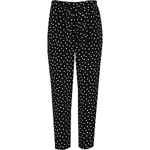 Pantalon fuselé noir à pois fille