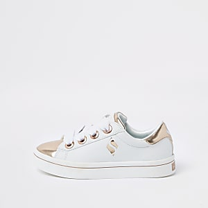 Girls Skechers white patent sneakers