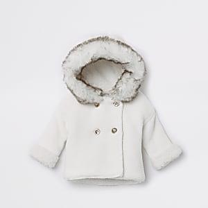 Cardigan en maille à capuche blanc avec fausse fourrure pour bébé