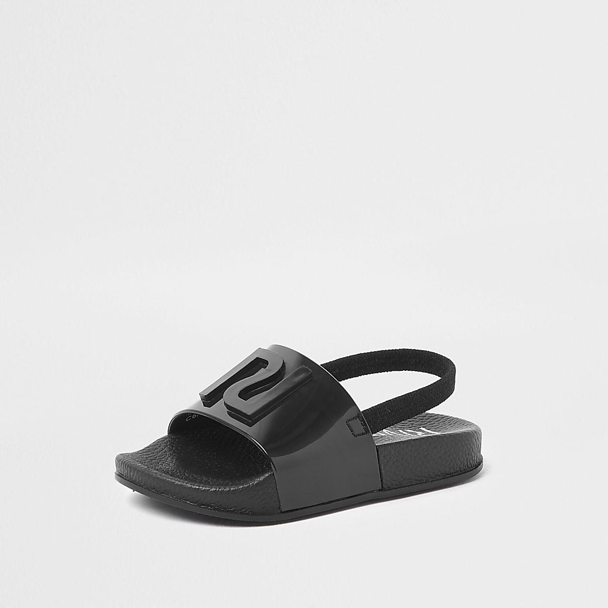443f849b84df3 Claquettes en plastique noires à logo RI pour mini enfant - Sandales ...