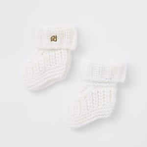 Crème gebreide sokken voor baby's