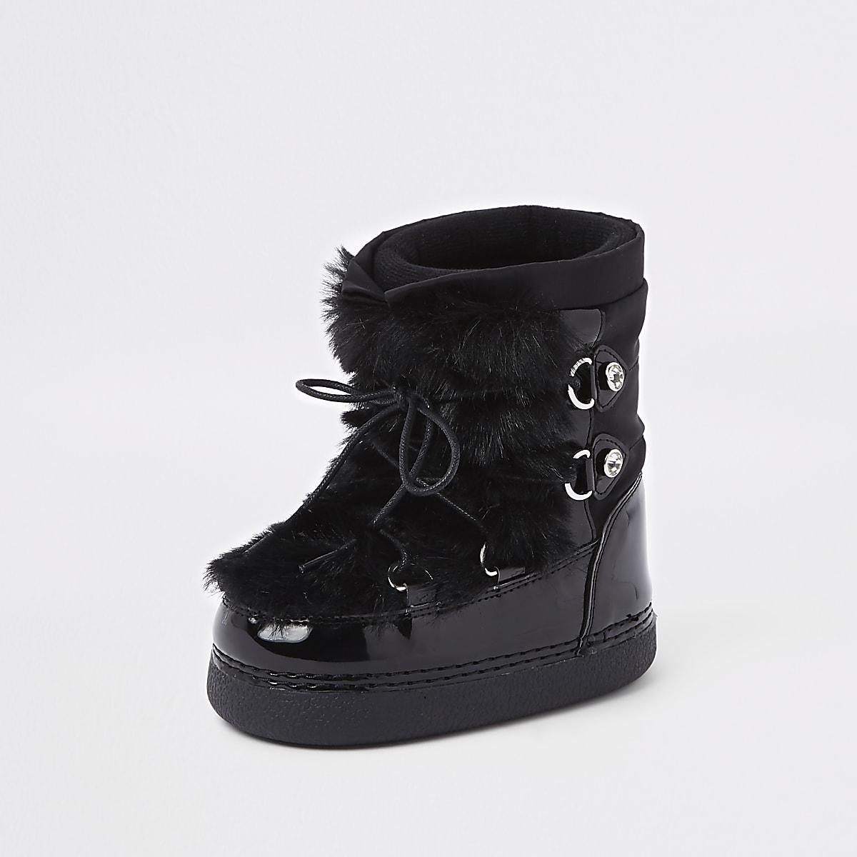 a9ab3f42eb760 ... Bottes de neige noires bordées de fausse fourrure mini fille ...