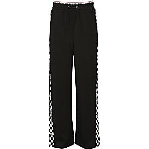 Pantalon noir avec bande latérale monochrome à boutons-pression fille