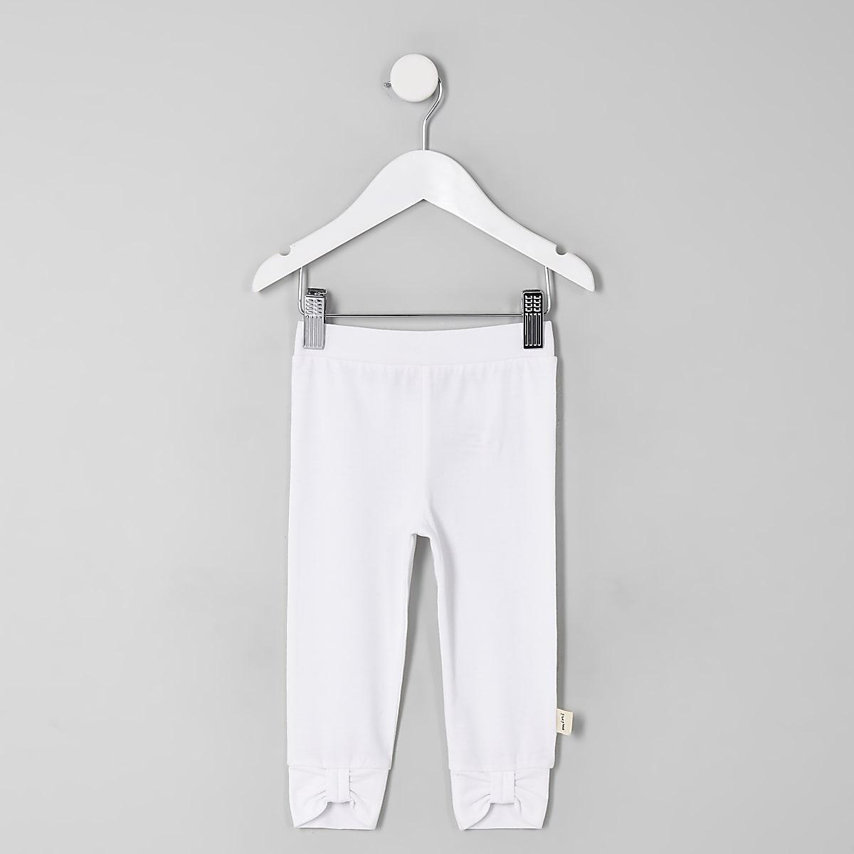 Weiße Leggings mit Schleife