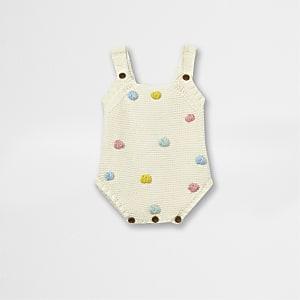 Crème rompertje met pompon voor baby's