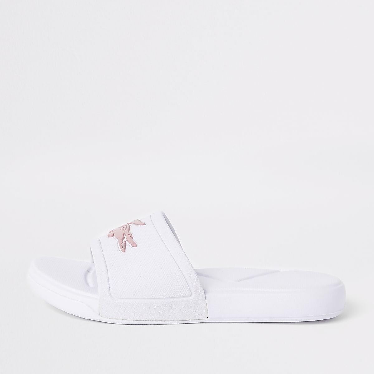 Girls Lacoste white embossed sliders