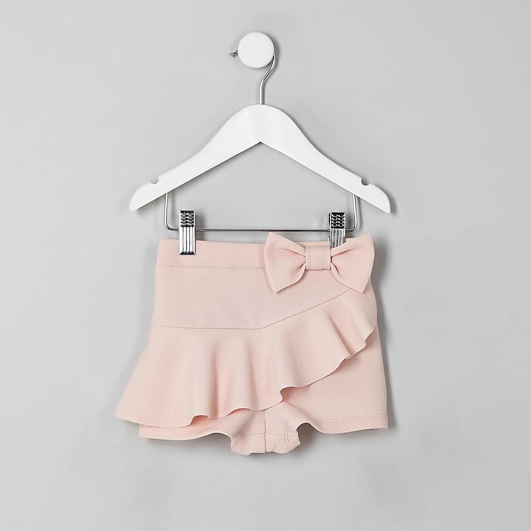 Mini - Roze skort met ruches en strik voor meisjes