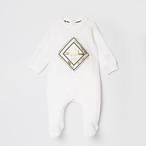 Crème onesie met RI-folieprint voor baby's