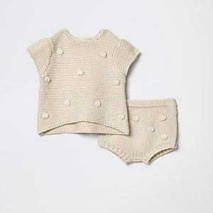 Crème gebreide outfit met pompon voor baby's