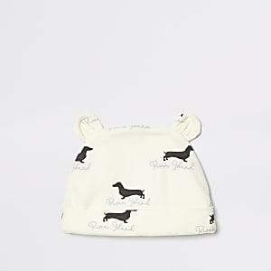 Bonnet imprimé chien crème pour bébé