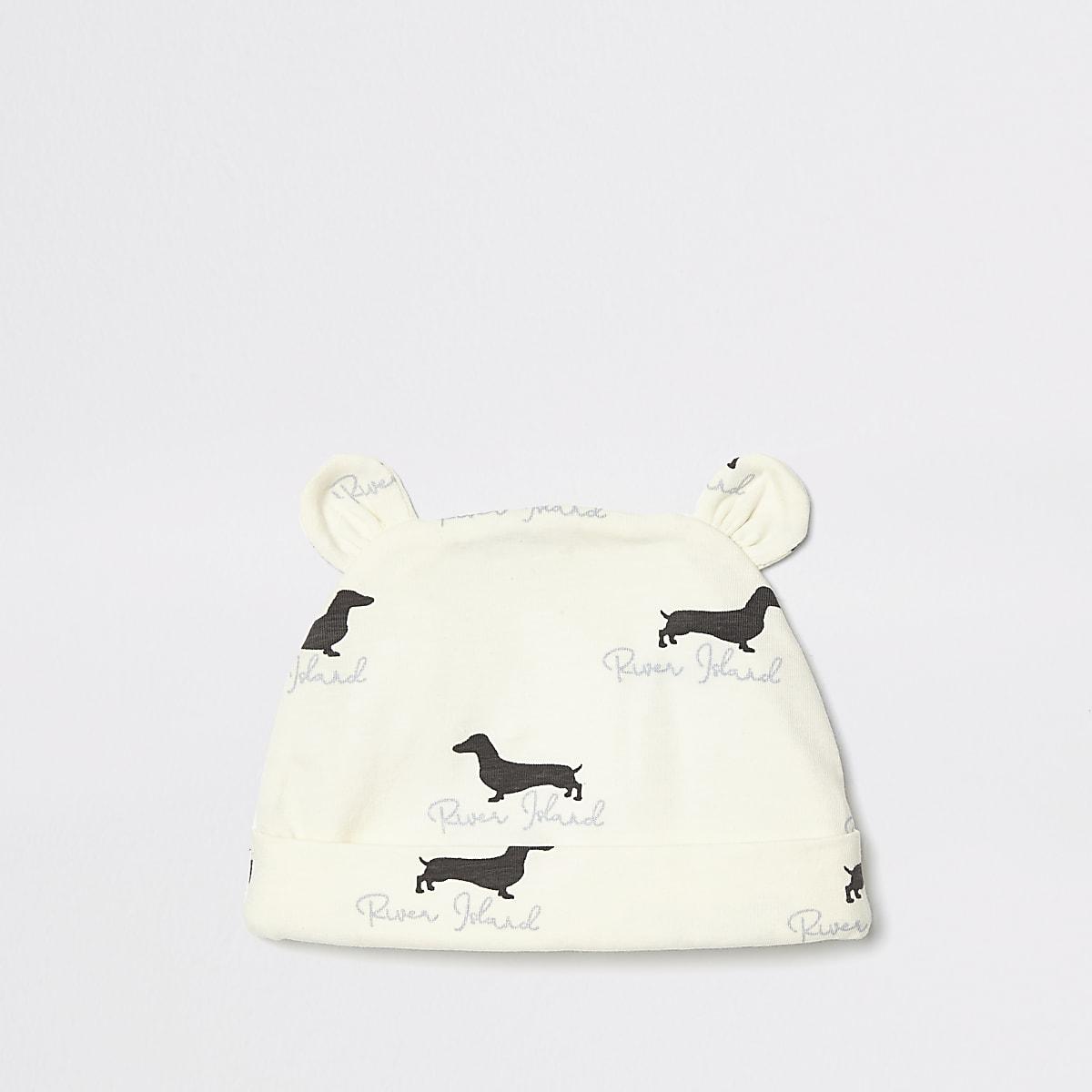 Crème beanie met hondenprint voor baby's