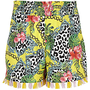 Girls yellow mixed print tassel trim shorts