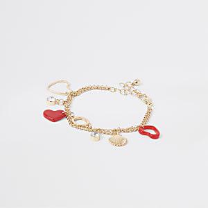 Bracelet doré avec breloques cœur rouges pour fille