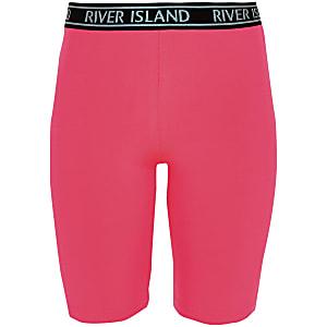 Short cycliste rose fluo à logo RI pour fille