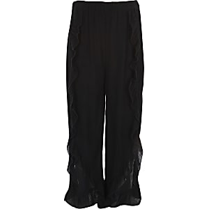 Girls black ruffle wide leg trousers