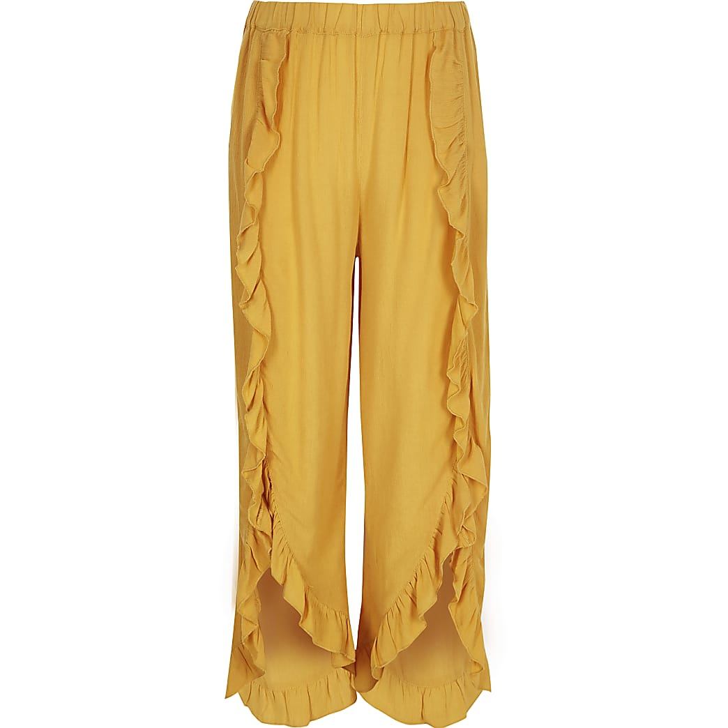Girls yellow ruffle wide leg trousers
