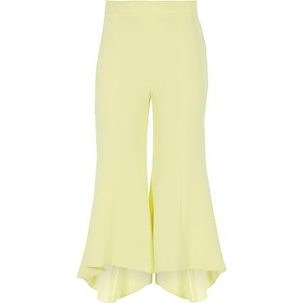 Girls yellow frill hem flared trousers