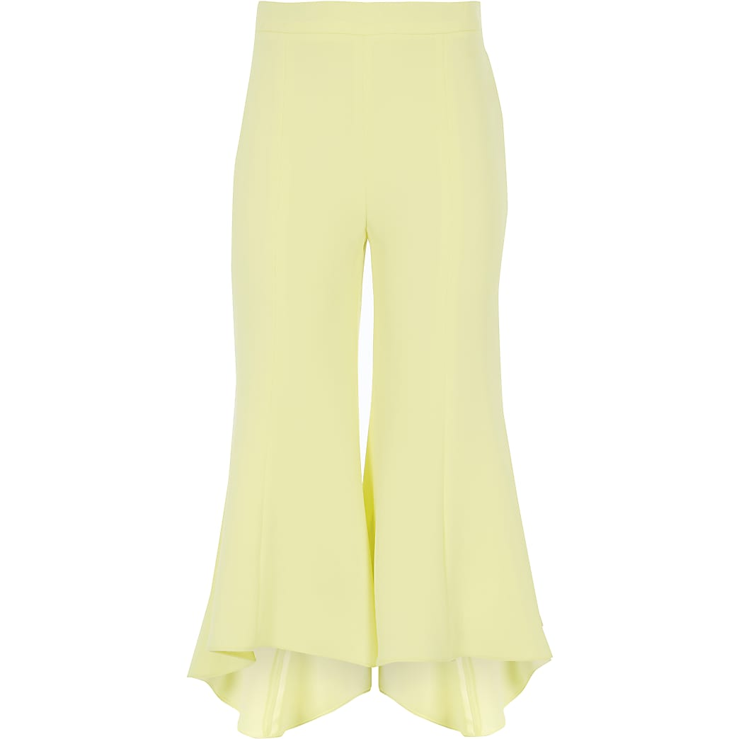 Girls yellow frill hem flared trousers